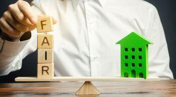 Rent Regulations, wooden blocks with the word Fair and a wooden house showing balance is needed
